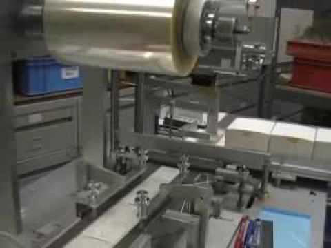Minipack over wrapping machine