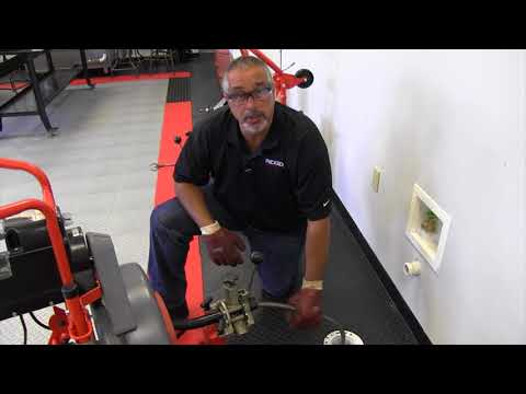 How to use the RIDGID K7500 drum machine power feed feature