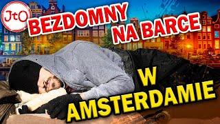 Bezdomny na barce w Amsterdamie