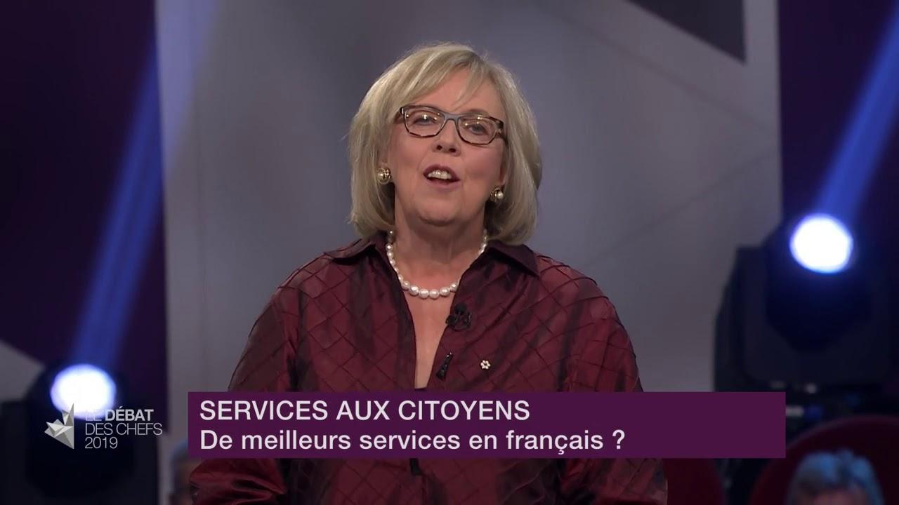Elizabeth May répond à la question d'un citoyen sur les services en français