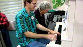 Mom and John: piano duet at church function, 2007