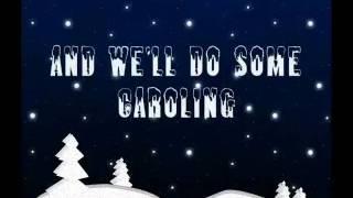 Miley Cyrus- Rockin' around the christmas tree (lyrics)