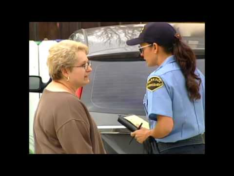 Humor video E-cards, Dina Eastwood plays a cop ticketing people for parking badly in their own driveways. Funny Humor