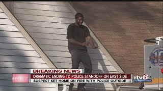 VIDEO: Man in police standoff dances on roof