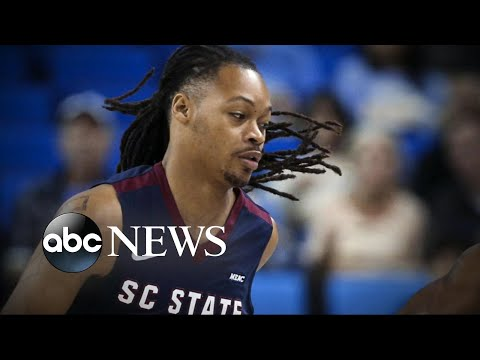 A college basketball player collapsed on the court during a game