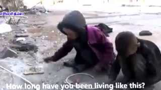 Syrian children eating breads crumbs from the floor!