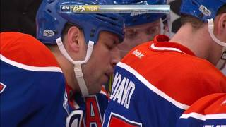 Lucic lays huge hit, draws penalty, then scores game-tying goal