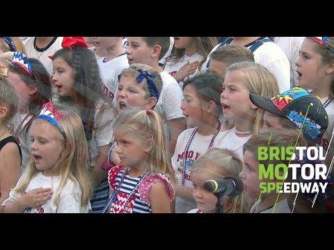 Drivers' kids sing National Anthem
