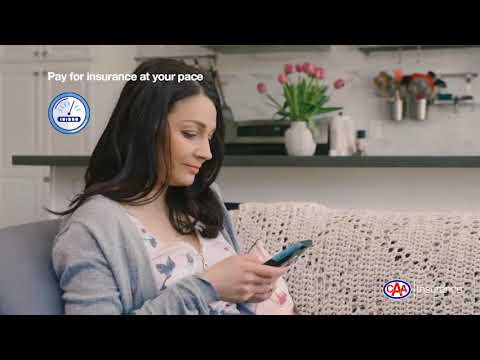 Woman sitting on a couch using a cell phone