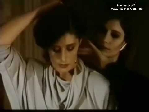 Bondage  movie scene- a woman is collared by another woman