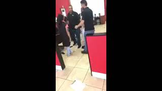 Women fights barber because she didn't like her hair