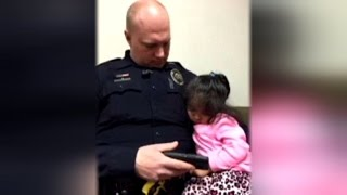 2-Year-Old Girl Falls Asleep in Cop