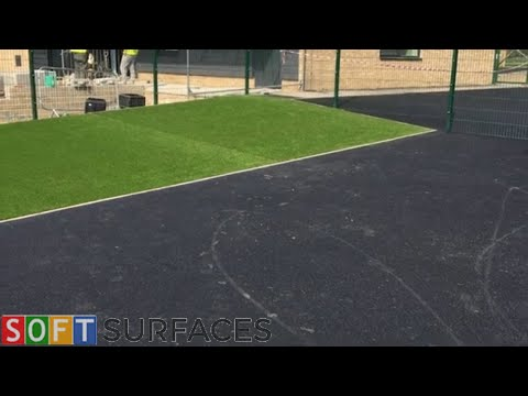 Black Wetpour & Artificial Turf Construction at a Nursery in Harlow, Essex | Wetpour Play Area