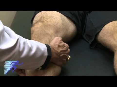 Palpacyjne badanie zapalenia kaletki maziowej kolana