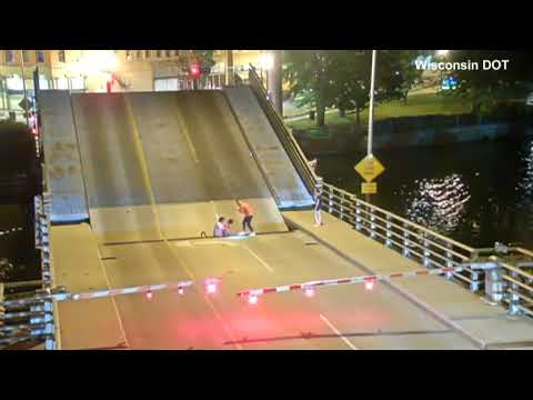 Video: Cyclist falls into the gap of a rising bridge