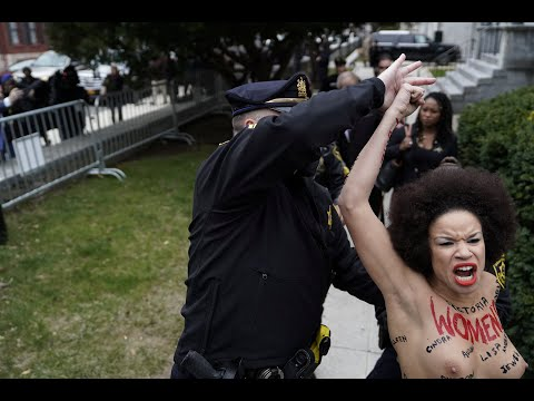Topless Protestor Jumps Out at Bill Cosby Before Retrial