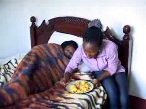 Kansiime Anne attending to a patient.