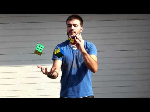 Can You Solve Rubik's Cubes While Juggling Them?