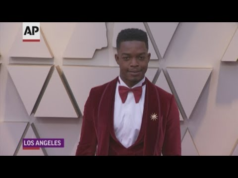 From Stephan James' red velvet tux to Billy Porter's tuxedo gown and Chadwick Boseman's tail jacket with sequins, men pushed the envelope at the Academy Awards. (Feb. 24)