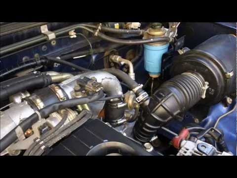 Фото к видео: How to change Fuel Filter on Nissan Navara d22, ZD30 Turbo Diesel Motor
