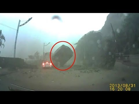 Amazing Footage Of Boulder ALMOST Crushing Car