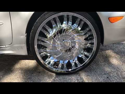 2004 Infiniti i35 on 22 inch Starr 458 chrome wheels and Carbon 235/30-22 tires