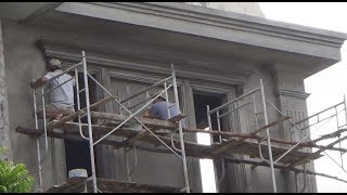 Construction Workers Making Creative Cornice With Trowels - Not Using Molding