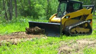 Skid track loader CAT 259 grading attachment - hmong video