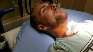 Draining a painful abscess on the upper throat