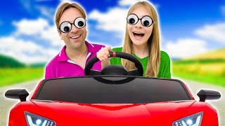Amelia and Avelina are helping dad, Akim ride-on car fun.