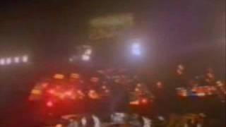 John Deacon Throws His Bass Guitar