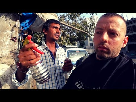 Youtuber gets a street haircut from a poor Indian man and then tips him enough money to expand his business