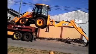 CLARKE IN ACTION with JCB backhoe