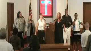 "Praise team singing ""Something Happens"""