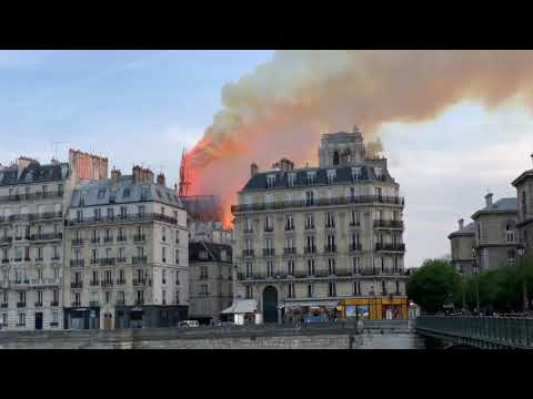 The main spire of the Notre Dame collapses