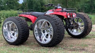 Fourwheeler on Giant $10,000 Rims goes Mudding