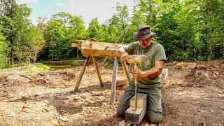Budowa warsztatu drewnianej konstrukcji szkieletowej, wyciskanie półtonowej kłody czarnego jesionu