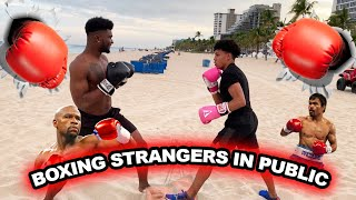 BOXING STRANGERS IN PUBLIC! | I Got Knocked Out...