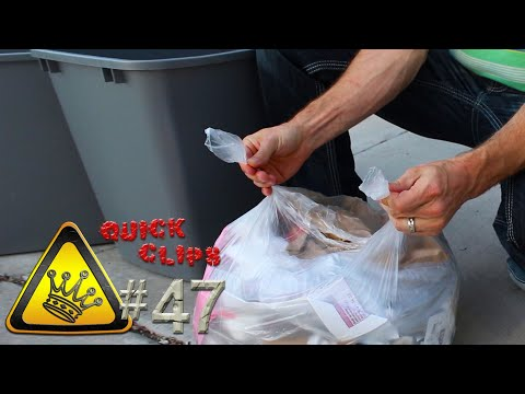 Tie A Garbage Bag More Easily By Flipping It A Few Times
