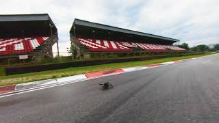 2 dji fpv drones on a race track
