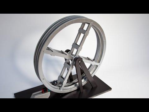 他慢慢的把磁鐵靠近金屬滾輪和裡面的鐵球接著發生驚人...