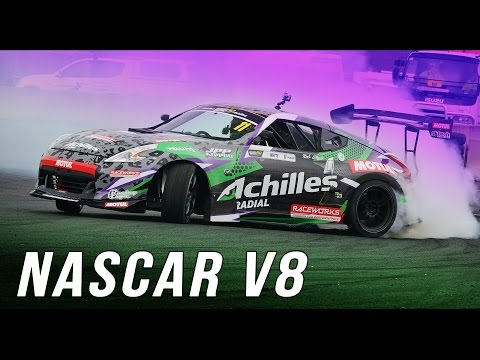 nissan 370z drift car with nascar dodge v8 demostrates turning right