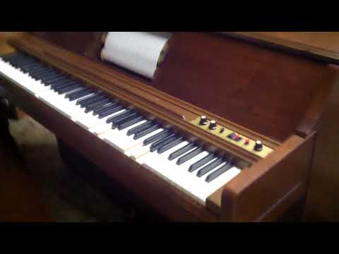 0 - Fun old fashion   player  piano  with  paper  rolls