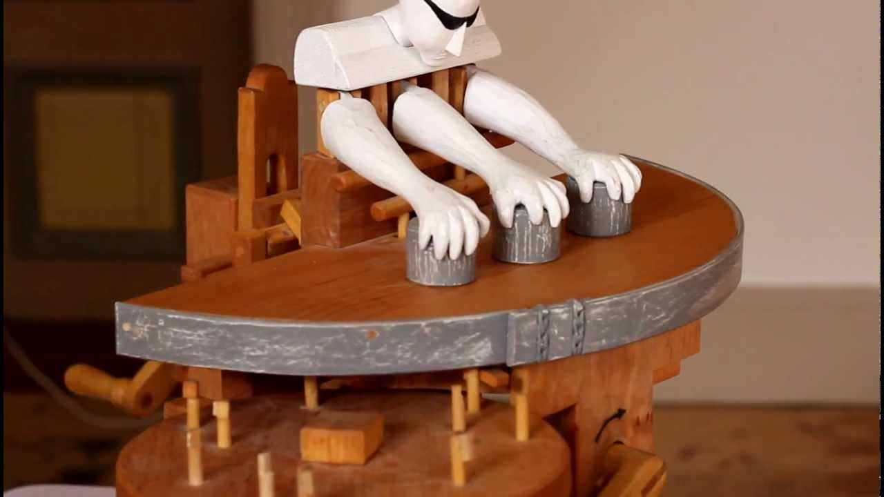 The Shell Game Has Nothing On This Wooden Robot With Three Arms