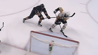 Crosby takes high stick from Kane while trying to score on empty net