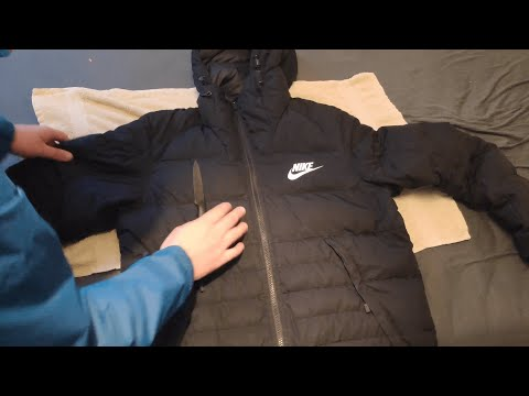 Ripping and Vacuum a little bit Nike Down Jacket