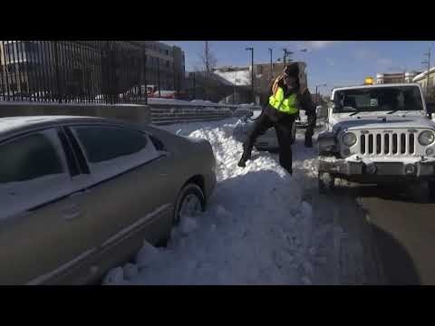 Milwaukee parking official Mark Lewis, who has to work outside in extreme cold, tries to keep a positive attitude (Jan. 29)