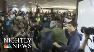 Demonstrators Stage Anti-Government Christmas Eve Protests In Hong Kong | NBC Nightly News