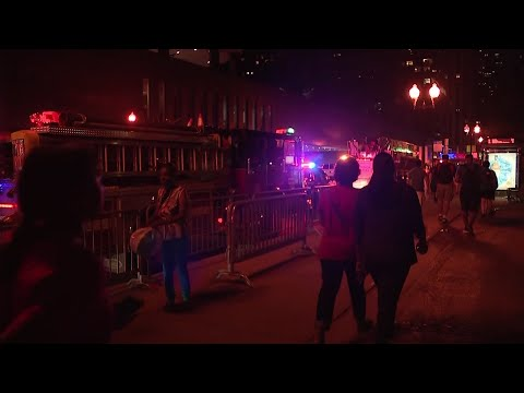 Police say a false report of gunfire set off a stampede that trampled more than a dozen people at Chicago's annual July 4 fireworks display at Navy Pier (July 5)