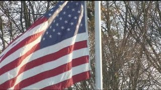 American flag flying at half-staff at Hampshire College days after one was burned